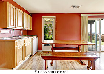 Red dining room with rustic table and bench