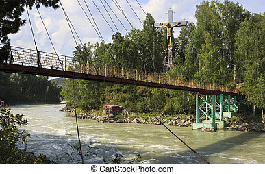 Suspension Bridge and cross with a crucifix on the island of the
