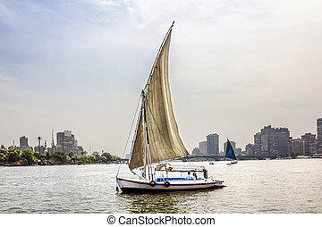 Sailboats on the Nile in Cairo in Egypt against the backdrop...