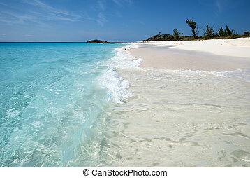 Pristine Beach - The wave hits the unspoiled pristine beach...