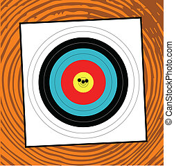 Grouping - A target with a grouping of bullet holes close to...
