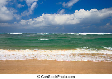 Peaceful beach scene with ocean and blue sky