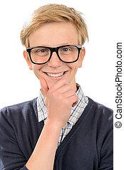 Happy teenage nerd boy wearing geek glasses against white...