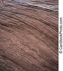 Slickrock background, close-up shot of a sandstone wave...