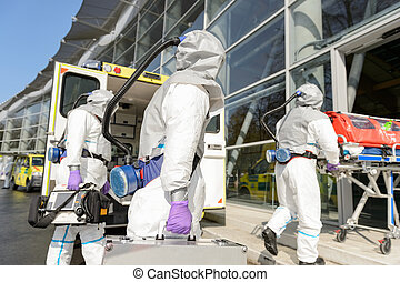 HAZMAT team entering contaminated building - HAZMAT team...