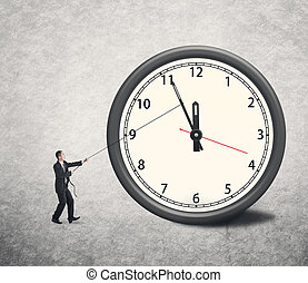 turn back time - Asian businessman trying to turn back time...