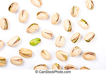 Pistachio nuts and one naked core isolated on white