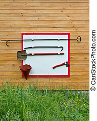 Shield with fire fighting tools - Shield with the tools to...