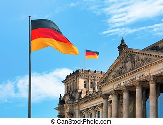 Berlin - waving flags in front of the Reichstag in Berlin