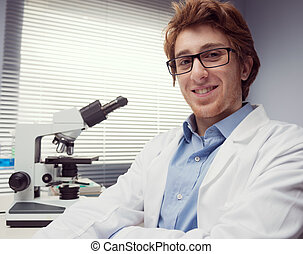 Young researcher in the laboratory - Student researcher...
