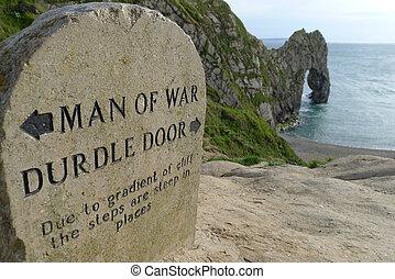 Durdle door sign and rock - Man of War Bay and Durdle Door,...