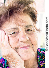 Old woman - Portrait of old and worried woman outdoor