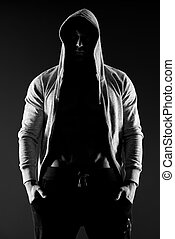 Hooded body builder - Confident body builder in hooded shirt...