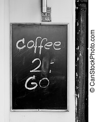 coffee to go - sign on a sidewalk cafe in Berlin