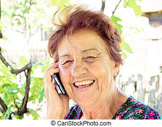Happy comunnication - Old lady using mobile phone and have...