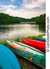 Canoes along the shore of Prettyboy Reservoir in Baltimore,...