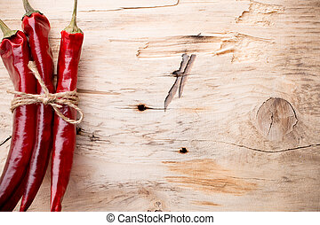 Chili. - Red chili peppers on a wooden background. The menu...