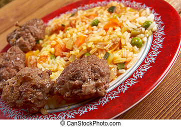Jollof rice also called Benachin is a popular dish in many...