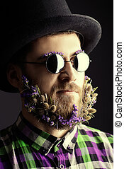 stranger - Strange young man with a beard of flowers wearing...