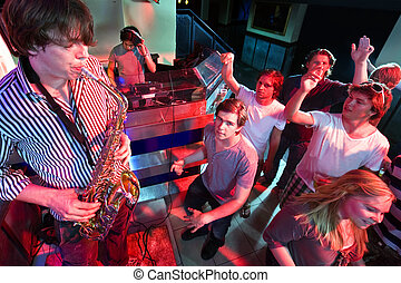 Sax Solo - Party crowd going wild during a solo of a...