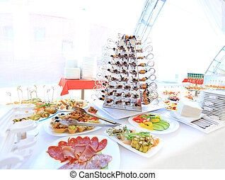 catering table set service with silverware and glass...