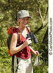 woman hiking - young blonde woman hiking and holding...