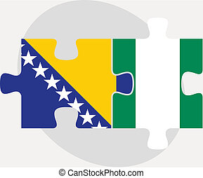 Bosnia Herzegovinan and Nigerian Flags in puzzle - Vector...