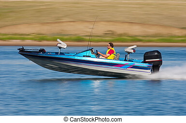 Fast Boat - Man driving a fast boat with panned (motion...