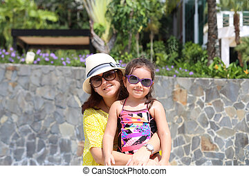 Mother and daughter enjoying the summer outdoors with fancy sung