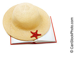 Straw hat with book and starfish isolated on white background