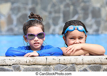 Portrait of two little girls in the pool