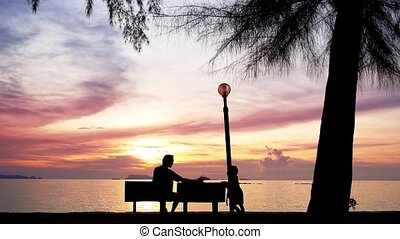 Father and Daughter enjoy the sunset. - Father and Daughter...