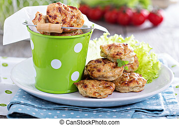 Tiny chicken burgers in a bucket for children