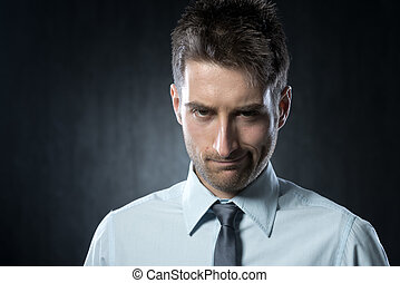 Suspicious businessman - Young businessman looking at camera...