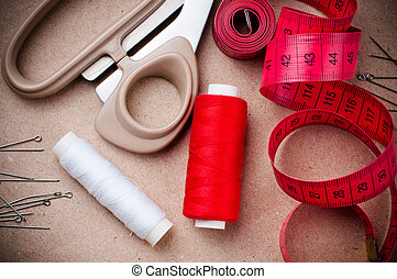 Tools for sewing and handmade: thread, scissors, pins on...