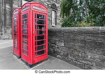Classic red British telephone box, B and W background -...