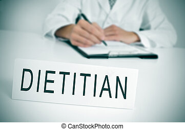 dietitian - a doctor sitting in a desk with a nameplate in...