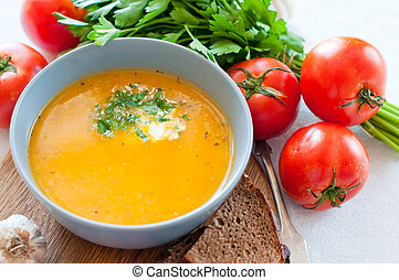 Dietetic vegetable soup in a ceramic bowl close-up