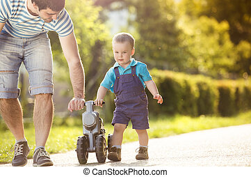 Father and son - Young father with his little son on...
