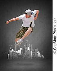 male dancer jumping in the air - dancing, happiness and...