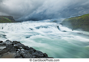 Icelandic waterfall - Beautiful Icelandic waterfall with...