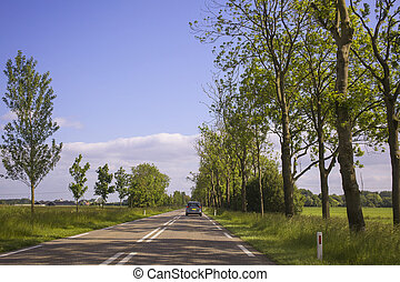 Car driving on an empty road - Car driving on an empty rural...