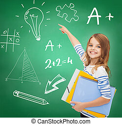 cute girl with folders pointing to green board - education,...