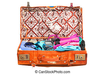 Packed for a beach vacation - Packed leather suitcase fdr a...