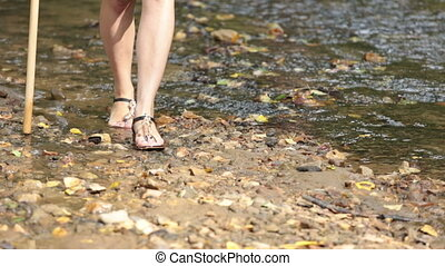 female legs barefoot along rive - female legs barefoot along...