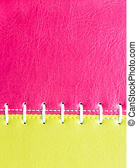 Pink and yellow  leather with white stitch close up