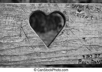 Heart cutout on with writing - Heart cut out on wooden bench...