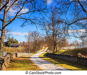 Kentucky country scene - Gravel road on a farm in Central...