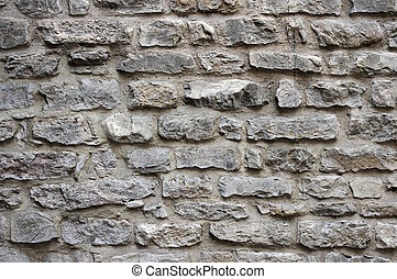 Pattern of old stone wall in Florence, Italy