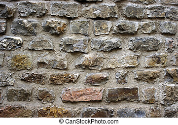 Pattern of ancient stone wall in Florence, Italy